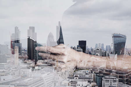 Media: Double exposure of success businessman using digital tablet with london building and social media diagram