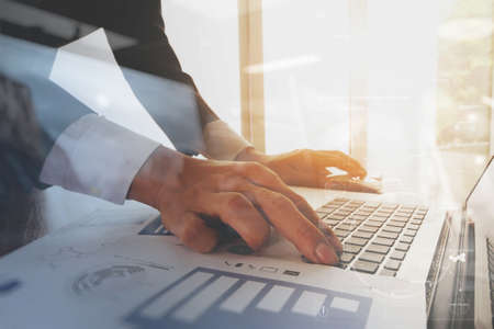 internet keyboard: business documents on office table with smart phone and digital tablet and graph business diagram and man working in the background