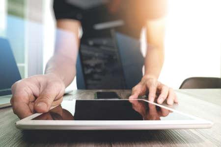 testing vision: Website designer working digital tablet and computer laptop and digital design diagram on wooden desk as concept Stock Photo