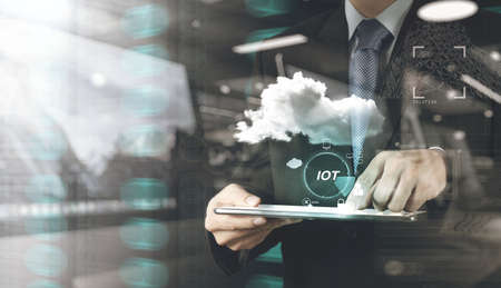 enveloped: double exposure of hand showing Internet of things (IoT) word diagram as concept Stock Photo