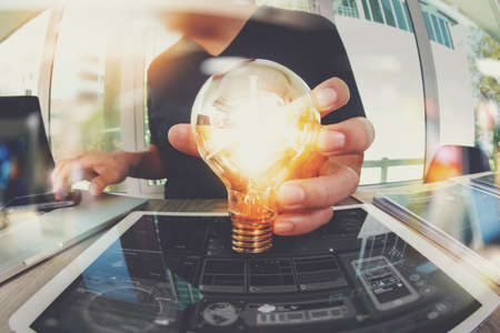 designer hand showing creative business strategy with light bulb as concept Stock Photo - 55731144