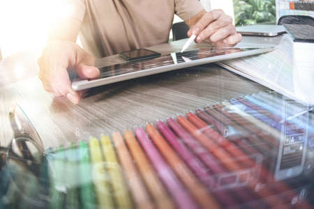 Website designer working digital tablet and computer laptop with smart phone and digital design diagram on wooden desk as concept Zdjęcie Seryjne