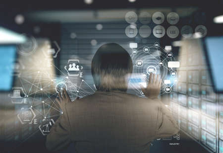 controlling: double exposure of businessman working on modern technology as concept