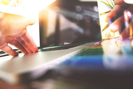 close up of Designer hand working with laptop computer on wooden desk as responsive web design concept Reklamní fotografie