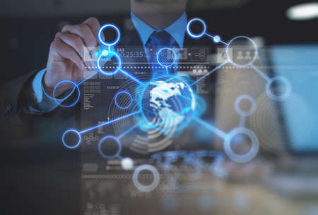 touch screen: double exposure of businessman working with new modern computer show social network structure as concept