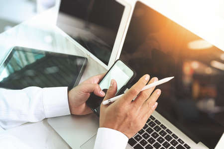 finance manager: Businessman hand touching digital tablet.Photo finance manager working new Investment project office.Using new technology device. sun flare effect