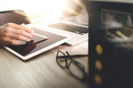 digital media: Website designer working blank screen digital tablet and computer laptop with compact server on wooden desk as concept