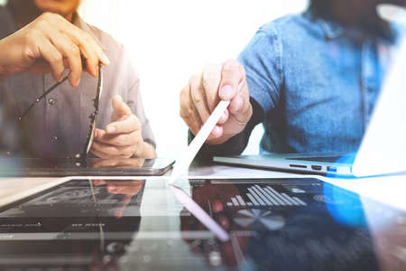 rate: Business team meeting present. Photo professional investor working with new startup project. Finance managers meeting.Digital tablet laptop computer design smart phone using. Blurred background, Sun flare effect,Horizontal