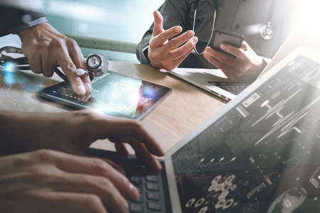 medical technology: Medical technology network team meeting concept. Doctor hand working smart phone modern digital tablet laptop computer graphics chart interface, sun flare effect photo Stock Photo
