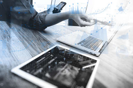 finance manager: Businessman hand touching digital tablet.Photo finance manager working new Investment project office.Using new technology device.Graphic icons.Strategy business stock exchanges interface ,black and white