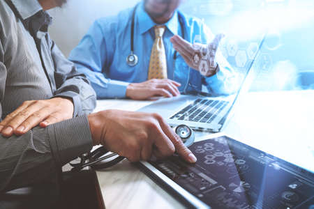 Medical technology network team meeting concept. Doctor hand working smart phone modern digital tablet laptop computer graphics chart interface, sun flare effect photo Stock Photo