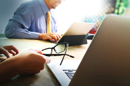 Business team meeting present. professional investor working new startup project. Finance managers meeting.Digital tablet keyboard docking screen computer design smart phone using, eyeglass hold Stock Photo