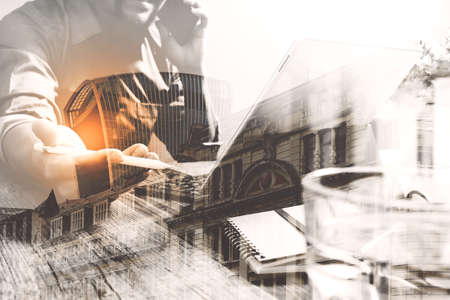 economic: Double exposure of success businessman using stylus pen,digital tablet docking smart keyboard  with London building,city,filter effect