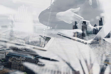 building a website: Double exposure of Photo website graphic designer hand meeting team with new project modern studio.Modern laptop digital tablet with London architecture,building