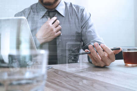 keyboard: success businessman hand using smart phone,digital tablet docking smart keyboard,coffee cup on wooden desk