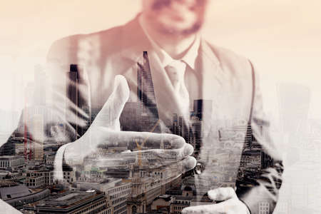 double exposure of businessman with an open hand ready to seal business investor project deal,front view,London buildings city