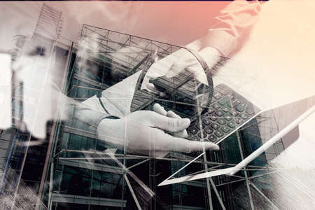 headset voice: double exposure of man hand using VOIP headset with digital tablet computer docking keyboard,smart phone,concept communication, it support, call center and customer service help desk,London architecture city