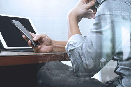 report icon: success businessman hand using smart phone,digital tablet docking smart keyboard on wood desk
