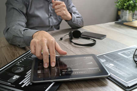 Businessman hand using VOIP headset with digital tablet computer,document,concept communication, it support, call center and customer service help desk