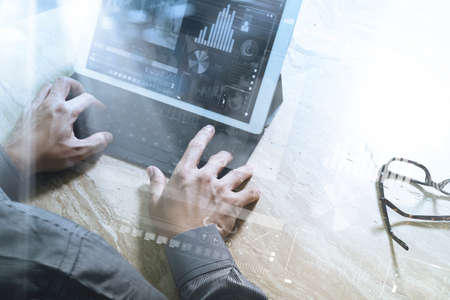 working on computer: Businessman hand working concept. Photo investor working with new startup project. Digital tablet keyboard dock screen computer design smart phone using. Eyeglass on marble desk. Sun flare effect
