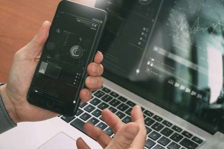 close up of hand using smart phone,laptop, online banking payment communication network technology 4.0,internet wireless application development sync app,filter effect 写真素材