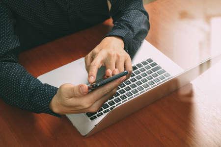 business man phone: top view,business man hand using smart phone,laptop, online banking payment communication network technology 4.0,internet wireless application development sync app,filter effect