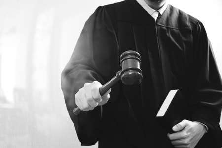 justice and law concept.Male judge in a courtroom with the gavel and holy book,black and white Stock Photo