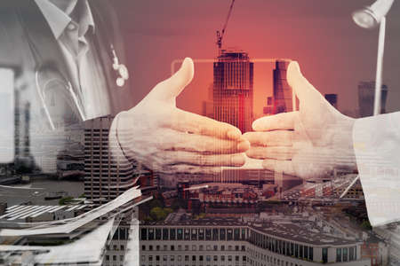 business help: Double exposure of Medical and health care concept,Doctor and patient shaking hands in modern office at hospital,London city