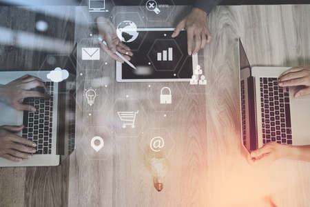 co working team meeting concept,businessman using smart phone and laptop and digital tablet computer in modern office with virtual interface icons network diagram
