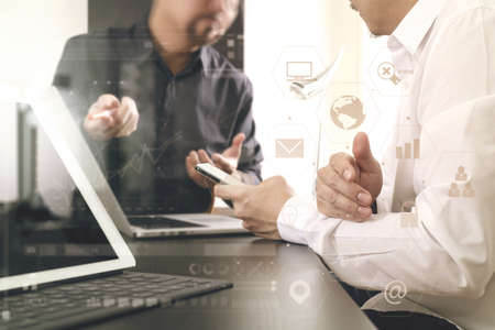 online: co working team meeting concept,businessman using smart phone and digital tablet and laptop computer in modern office with virtual graph chart and icon diagram