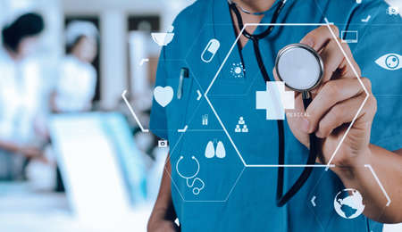 Healthcare and Medicine concept.smart medical doctor working with stethoscope at modern hospital Stock Photo