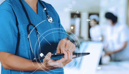 Medical technology concept.Smart Doctor using digital tablet computer find information patient medical at the hospital with VR icon diagram with VR icon diagram Stock Photo