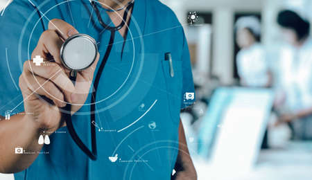 Healthcare and Medicine concept.smart medical doctor working with stethoscope at modern hospital with VR icon diagram with VR icon diagram
