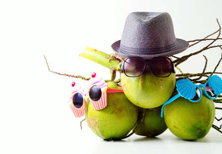 Family Summer and holiday symbolic concept.group of coconuts with design sunglasses and summer beach items on white background