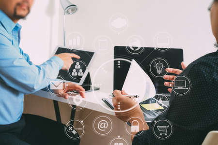 co working team meeting concept,businessman using smart phone and digital tablet and laptop computer in modern office with virtual icon graph and chart
