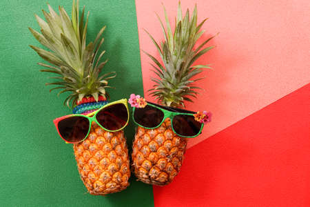 Summer and Holiday concept.Hipster Pineapple Fashion Accessories and Fruits on colorful background