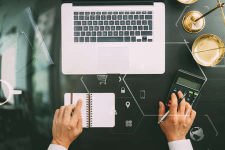 justice and law concept.businessman or lawyer or accountant working on accounts using a calculator and laptop computer and documents with Vr diagram Stock Photo