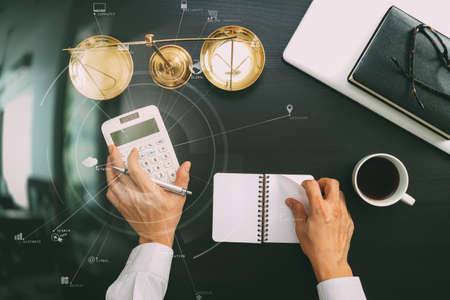 justice and law concept.businessman or lawyer or accountant working on accounts using a calculator and laptop computer and documents with Vr diagram Stockfoto