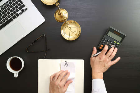 Justice and law concept.businessman or lawyer or accountant working on accounts using a calculator and laptop computer and documents in modern office Banque d'images