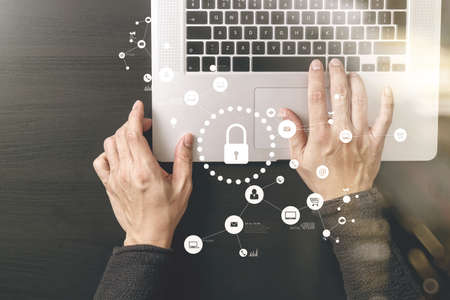 Cyber security internet and networking concept.Businessman hand working with VR screen padlock icon diagram on laptop computer