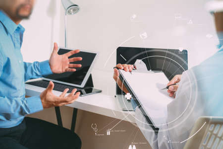 Medical doctor in white uniform gown coat consulting businessman patient having exam as Hospital professionalism concept with VR icon diagram Banque d'images