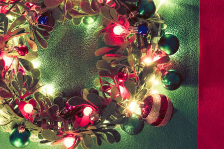 Greeting Season concept.Christmas wreath with decorative light on green background