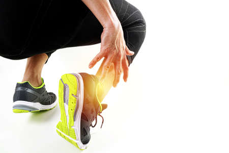 Runner sportsman holding ankle in pain with Broken twisted joint running sport injury and Athletic man touching foot due to sprain on white background Reklamní fotografie - 85987491