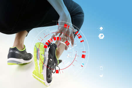 Runner sportsman holding ankle in pain with Broken twisted joint running sport injury and Athletic man touching foot due to sprain with VR medical scanning Stock Photo - 88995821