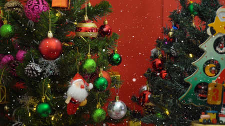 Greeting Season concept.Santa Claus show 3 days till Xmas with ornaments on a Christmas tree with decorative light Stock Photo