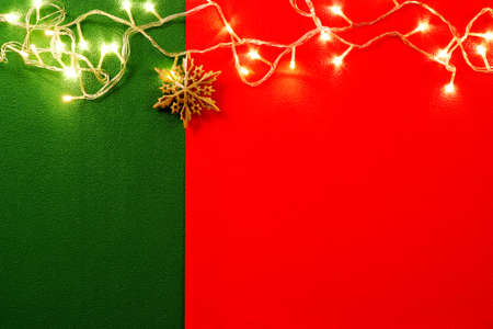 Greeting Season concept.Christmas light and pine star on red and green background