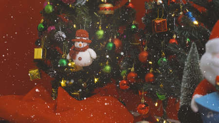Greeting Season concept. Snow man with ornaments on a Christmas tree with decorative light