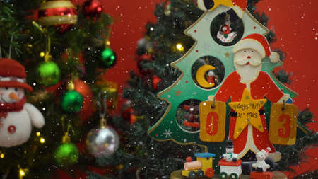 Greeting Season concept. Santa Claus show 3 days till Xmas with ornaments on a Christmas tree with decorative light Standard-Bild
