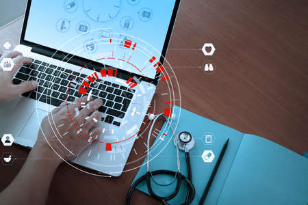 Medical technology concept,smart doctor hand working with modern computer in hospital office with virtual icon diagram