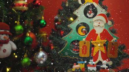 Greeting Season concept.Santa Claus show 4 days till Xmas with ornaments on a Christmas tree with decorative light
